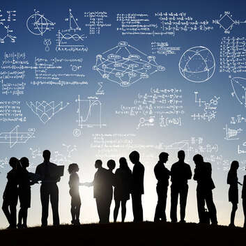 silhouettes of a group of people with backdrop of equations