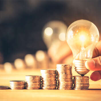 Image of light bulb and coins