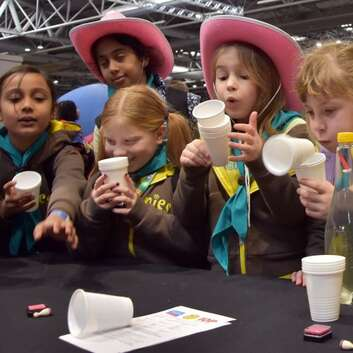 A group of Brownies try a physics experiment