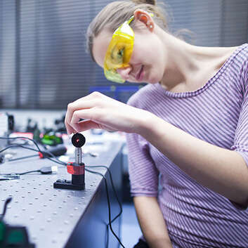 Female physics student in laboratory