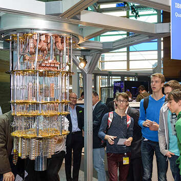 Young boys view an IBM quantum computer at an exhibition