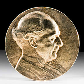 Medal shows a portrait of Fernand Holweck