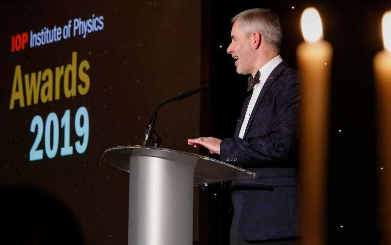 Paul Hardaker giving a speech at a podium at the IOP Awards dinner 2020