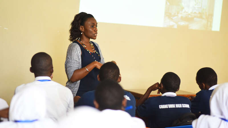 A business mentor shares her knowledge with high school students in Tanzania