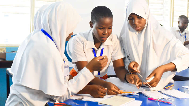 High school students in Tanzania doing a physics activity